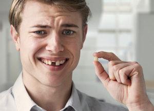 Как безболезненно вырвать зуб самостоятельно