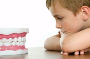 ноет зуб у ребенка фото